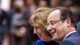 French President Francois Hollande, right, talks next to EU foreign policy chief Catherine Ashton, during an EU summit at the European Council building in Brussels, Friday, Dec. 20 2013.