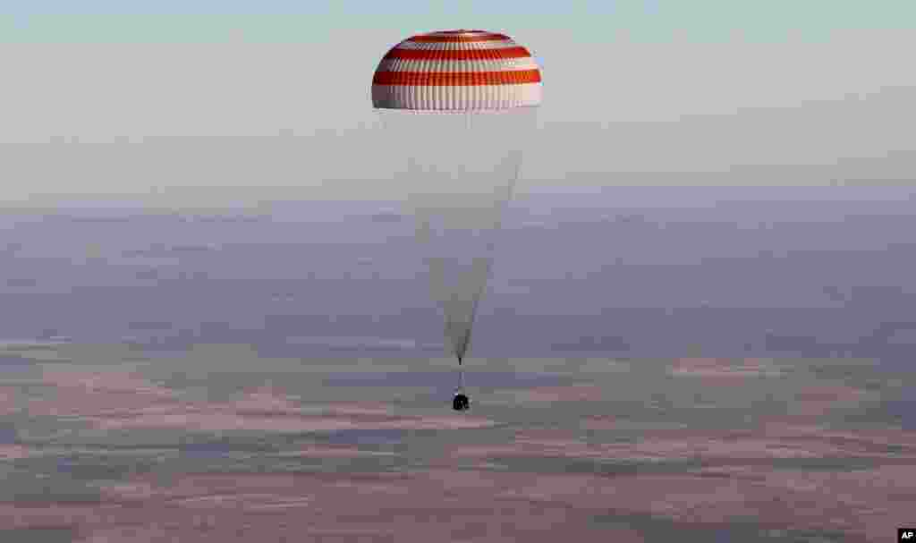 A Russian Soyuz MS-08 space capsule lands about 150 kilometers southeast of the Kazakh town of Dzhezkazgan, Kazakhstan.