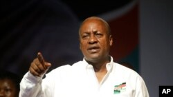 Ghana Incumbent President, John Dramani Mahama candidate of the National Democratic Congress gesture to his supporters during a presidential election rally at Accra Sports Stadium in Accra, Ghana, Monday, Dec. 5, 2016. The Ghana election will take place on Dec. 7.