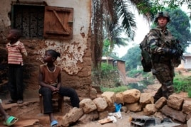 A French soldier patrols in a neighbourhood during a daytime patrol as shooting continued overnight the capital Bangui, Central African Republic, Dec. 26, 2013.