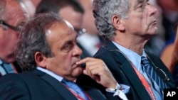 FILE - FIFA vice president Angel Maria Villar Llona (right) and UEFA President Michel Platini attend the preliminary draw for the 2018 soccer World Cup in Konstantin Palace in St. Petersburg, Russia, July 25, 2015.