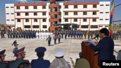 """Bolivia's President Evo Morales (R) speaks during the inauguration of the military school which Bolivia's government said would teach an """"anti-imperialist"""" doctrine in Warnes near Santa Cruz, Bolivia, Aug. 17, 2016. (Courtesy of Bolivian Presidency/Handout)"""