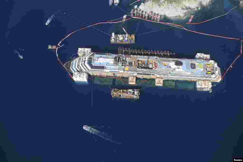 An aerial view of the Costa Concordia cruise liner is seen during the refloat operation at Giglio harbor on Giglio Island in this handout photograph released by Italian Civil Protection.