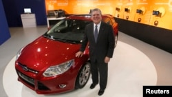 Dave Schoch, chairman and CEO of Ford Greater China, poses in Ford's booth in Taipei, June 4, 2012.