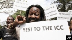 Kenyan protesters hold placards while shouting slogans during a protest in Nairobi, Jan 18 2011