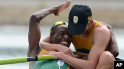 South African rowers Sizwe Ndlovu, left, and John Smith embrace after winning the gold medal in the men's lightweight four rowing final at the London 2012 Summer Olympics, August 2, 2012.