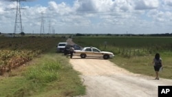 Police cars block access to the site where a hot air balloon crashed near Lockhart, Texas, July 30, 2016. At least 16 people were on board the balloon, which a Federal Aviation Administration spokesman said caught fire before crashing into a pasture.