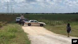 警車在出事地點附近封鎖道路(2016年7月30日)