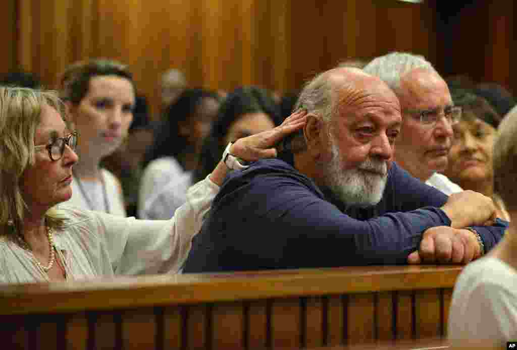 Reeva Steenkamp's father, Barry Steenkamp (right), cries while comforted by his wife as they listen to proceedings during the third day of sentencing for Oscar Pistorius, at the high court in Pretoria, South Africa, Oct. 15, 2014.