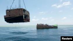 Các giới chức ước tính tàu dọn mìn USS Guardian của Mỹ bị mắc cạn trong 73 ngày tại rạn san hô Tubbataha đã gây hư hại cho hơn 2.200 mét vuông san hô ở đây