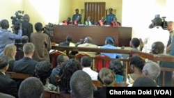 Reporters were allowed in to the packed courtroom in the morning when preliminary hearings began on March 11, 2014for four South Sudanese political detainees accused of involvement in an alleged coup bid.