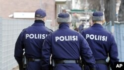 FILE - Finnish police officers are seen on patrol in Tampere, Finland.