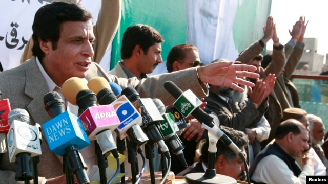 Chaudhry Pervez Elahi speaks to supporters at a campaign rally in Kasur, about 55 km south of Lahore, February 14, 2008.