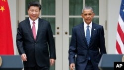 FILE - President Barack Obama and Chinese President Xi Jinping arrive for their joint new conference, Sept 25, 2015.