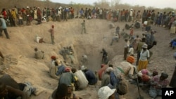 FILE - Miners digging for diamonds in Marange, eastern Zimbabwe, Nov. 1, 2006.