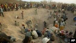 FILE - Miners digging for diamonds in Marange, eastern Zimbabwe, Nov. 1, 2006.