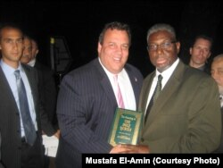 Imam Mustafa El-Amin presents New Jersey Gov. Chris Christie with the Holy Quran, July 24, 2012.