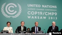 Officials at the COP19 conference at the National Stadium in Warsaw, Nov. 19, 2013.