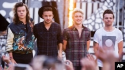 """FILE - One Direction members, from left, Harry Styles, Liam Payne, Niall Horan and Louis Tomlinson perform on ABC's """"Good Morning America,"""" Aug. 4, 2015."""