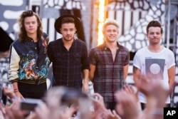 "FILE - One Direction members, from left, Harry Styles, Liam Payne, Niall Horan and Louis Tomlinson perform on ABC's ""Good Morning America""."