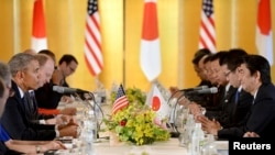U.S. President Barack Obama speaks to Japanese Prime Minister Shinzo Abe (R) during their meeting at the Akasaka Palace in Tokyo, April 24, 2014.