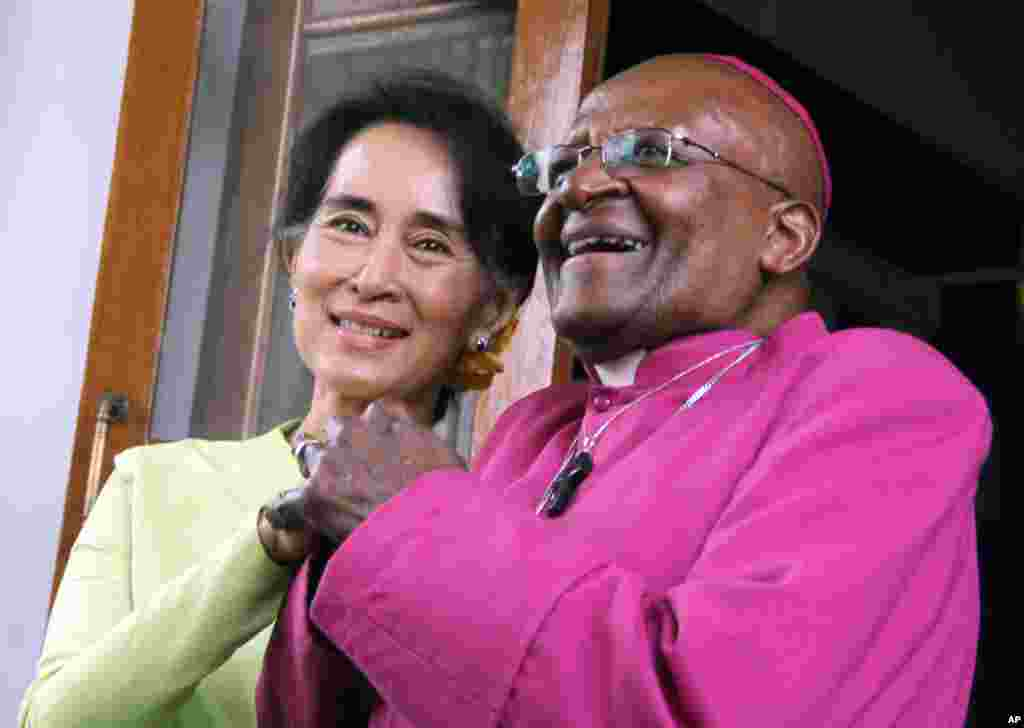 South African Archbishop Desmond Tutu and Burma's opposition leader Aung San Suu Kyi are seen during a press briefing at her residence in Rangoon, Burma.