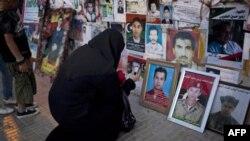 Фотографии убитых и пропавших без вести во время правления Муаммара Каддафи. Бенгази. 16 мая 2011 года