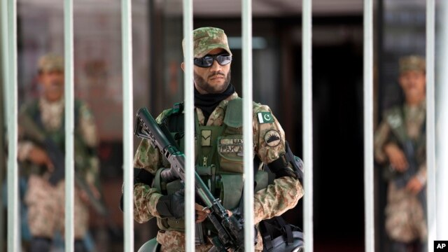 In Islamabad, Pakistani army soldiers stand guard during an emergency session of parliament, with thousands of protesters demanding the prime minister's resignation Sept. 2, 2014.