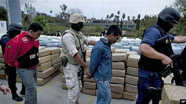 Soldiers and police officers escort detainees after a conjoined operation with the army, local and state police seized 105 tons of U.S.-bound marijuana in Tijuana, Mexico, 18 Oct 2010