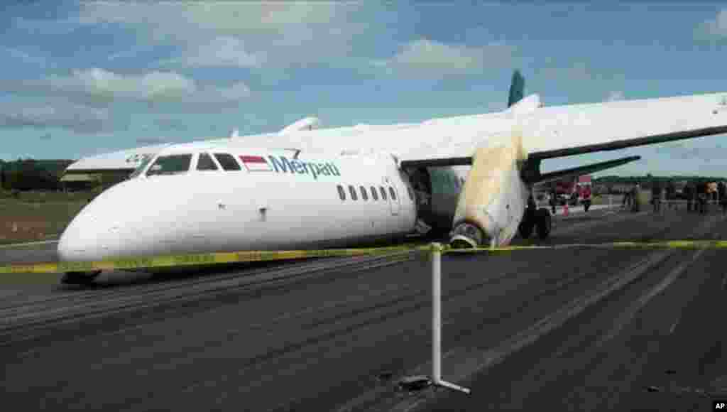 The wreckage of a Chinese-made Xian MA60 twin turboprop aircraft operated by state-run Merpati Nusantara Airlines lies on the runway after it landed hard, slamming both engines onto the runway at El Tari airport in Kupang, East Nusa Tenggara, Indonesia.