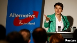 FILE - Frauke Petry, chairwoman of the anti-immigration party Alternative for Germany, attends a meeting in Berlin, Germany, Sept. 16, 2016. Petry, riding a wave of anti-immigrant sentiment in Germany, is seen as a serious challenger for Merkel in 2017.