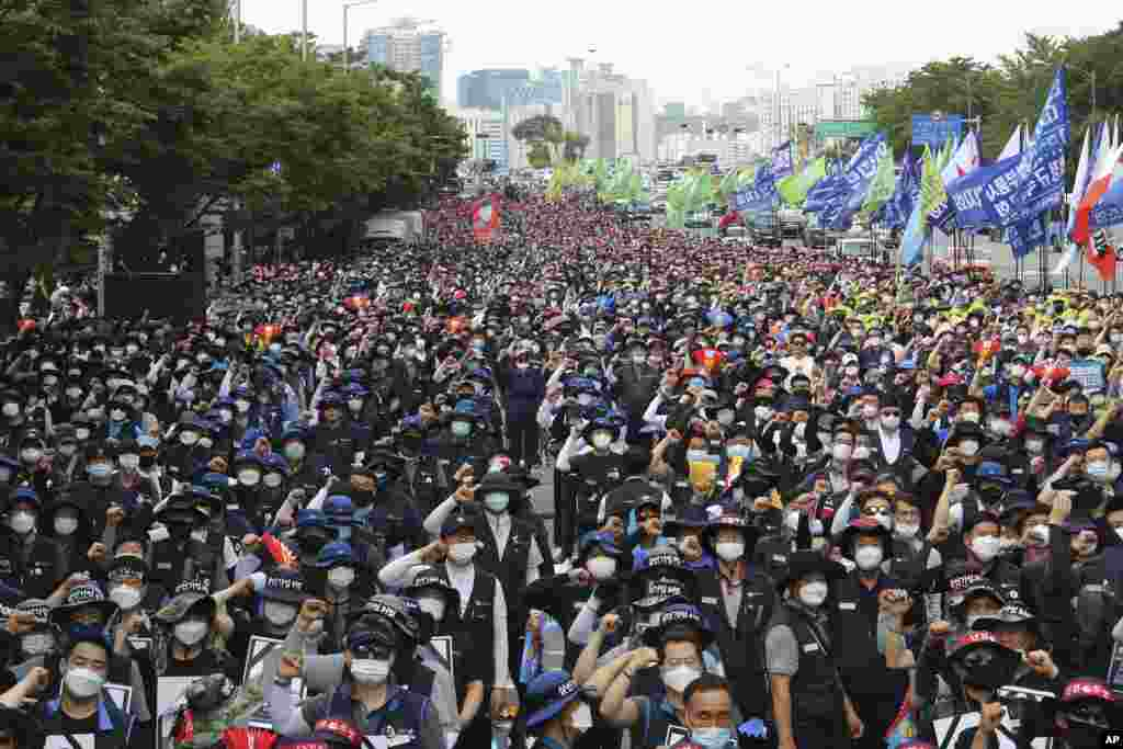Workers protest the government's labor policy at a demonstration in Seoul, South Korea.