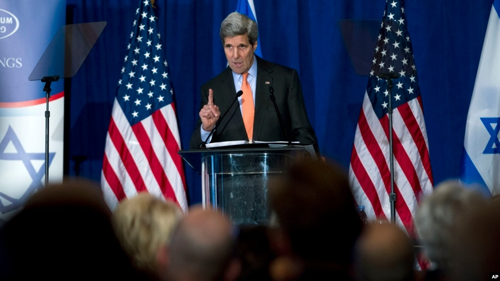 "FILE - U.S. Secretary of State John Kerry speaks to the Saban Forum in Washington, D.C., Dec. 7, 2014. Speaking Sunday at the annual forum, Kerry said that the peace process between Israel and the Palestinians is ""getting worse"" and ""moving in the wrong direction."""
