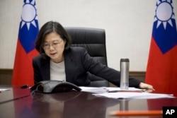 FILE - Taiwan's President Tsai Ing-wen speaks with U.S. President-elect Donald Trump through a speaker phone in Taipei, Taiwan. (Taiwan Presidential Office via AP)