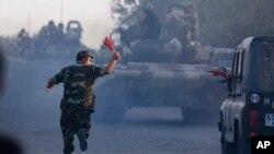 Азербайджанские танки выдвигаются в город Агдам. Азербайджан. 2 апреля 2016 г.