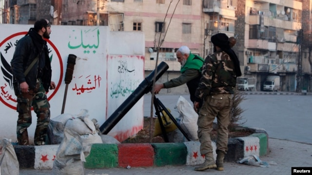 Free Syrian Army fighters prepare to launch a mortar towards fighters from the Islamic State in Iraq and the Levant from a street in the Kadi Askar neighborhood of Aleppo, Jan. 7, 2014.