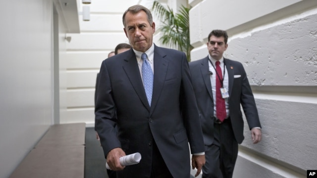 House Speaker John Boehner of Ohio walks to a closed-door Republican strategy session, Wednesday, Dec. 5, 2012, on Capitol Hill in Washington.