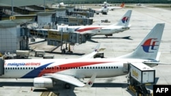 FILE - Malaysia Airlines aircraft are seen at Kuala Lumpur International Airport in Sepang, March 25, 2014.