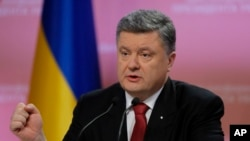 Ukrainian President Petro Poroshenko gestures during a press conference in Kyiv, Ukraine, Dec 29, 2014.
