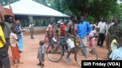South Sudanese gather in front of the Zereda center, which increases awareness of HIV, in Western Equatoria state.