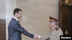 Suriye Devlet Başkanı Beşar Esad yeni Genelkurmay Başkanı General Ali Eyyüb ile..