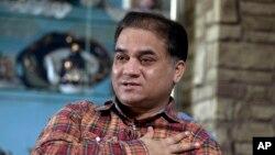 維吾爾族學者伊利哈木土赫提。(2013年2月4日)