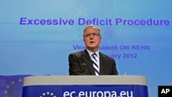 European Economic and Monetary Affairs Commissioner Olli Rehn addresses a news conference at the EU Commission headquarters in Brussels, January 11, 2012.