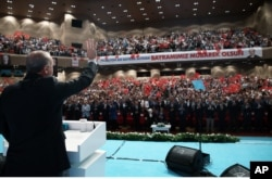 Turkish President Recep Tayyip Erdogan salutes people gathered to celebrate the Muslim holiday of Eid al-Adha in Istanbul, Sept. 13, 2016. Erdogan said Monday the country will send food, clothing and children's toys to Aleppo, Syria after a U.S.-Russia brokered ceasefire takes effect.