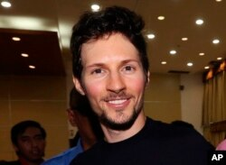 FILE - Telegram founder Pavel Durov smiles following his meeting with Indonesian Communication and Information Minister Rudiantara in Jakarta, Indonesia, Aug. 1, 2017.