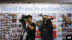 Thai video journalists working at Thai Journalists Association during the International World Press Freedom Day before a press conference in Bangkok, Thailand, May 3, 2017.