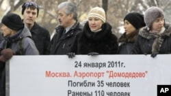 Liberal Yabloko party members picket in downtown Moscow, Russia, demanding information on the investigation into the Moscow airport blast. The poster reads: 'Jan. 24, 2011, Airport Domodedovo, 35 Killed, 110 Injured, Who is to Blame ?' (File Photo)