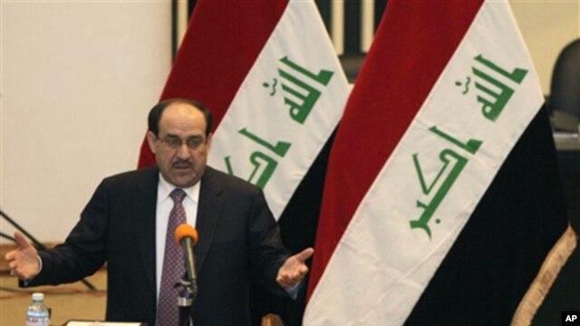 Iraq's Prime Minister Nouri al-Maliki in Baghdad, 21 Dec 2010