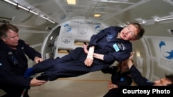 Stephen Hawking, almost totally paralyzed since 1970 by ALS, enjoys a few moments of weightlessness during a flight aboard Zero Gravity Corp.'s modified Boeing 727. (Jim Campbell, Aero-News Network)