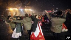 North Koreans dance on the Kim Il Sung Square to celebrate a satellite launch, Feb. 8, 2016, in Pyongyang, North Korea.